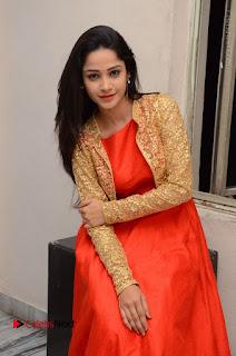 Telugu Actress Divya Nandini Stills in Orange Sleeveless Gown at Chennai Chaitrama Movie le Launch Event  0101.JPG