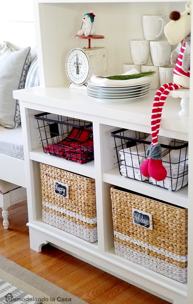 base cabinets holding storage baskets for Christmas decor
