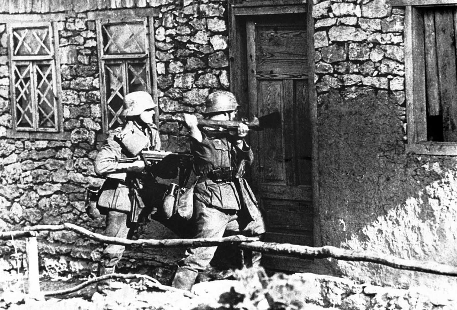 German infantrymen force their way into a snipers hide-out, where Russians had been firing upon advancing German troops, on September 1, 1941.