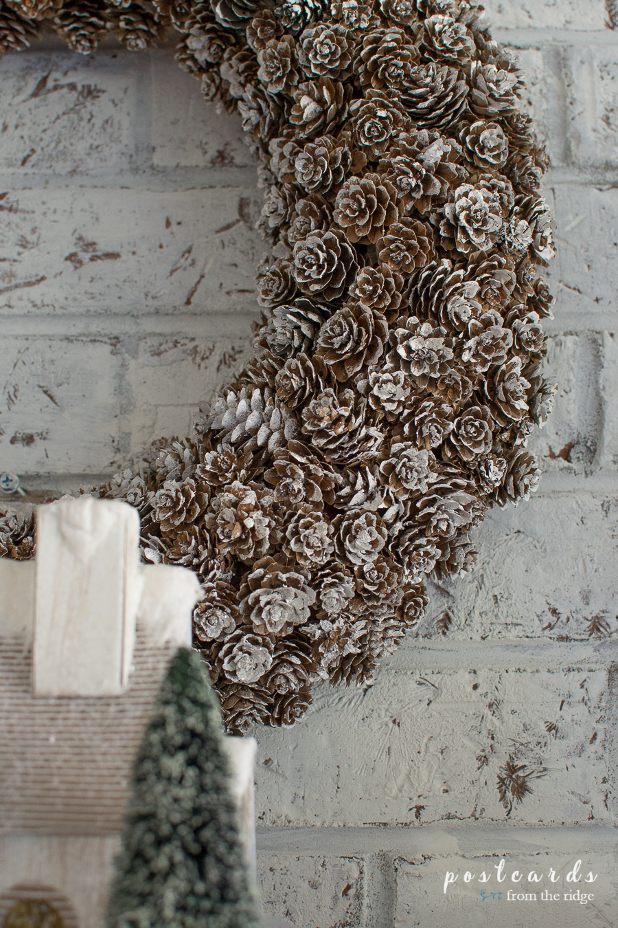 pine cone wreath on a farmhouse Christmas mantel