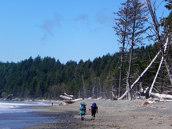 Two Backpackers on the Beach Trail