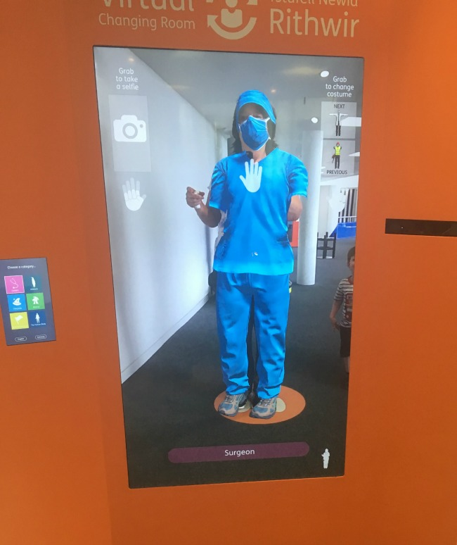 Techniquest-Virtual-Reality-changing-room-a-toddler-explores-an-image-of-a-surgeon