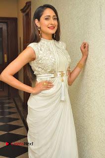 Actress Pragya Jaiswal Stills in Beautiful White Dress at turodu Audio Launch  0014.JPG