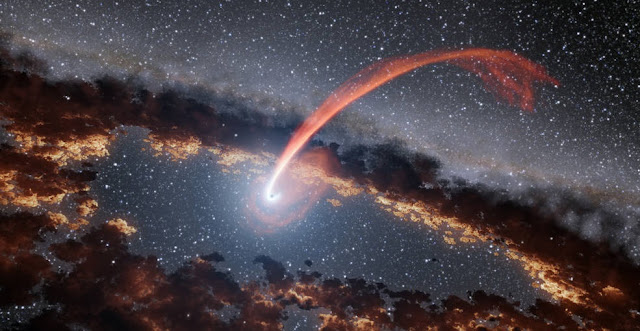 This illustration shows a glowing stream of material from a star as it is being devoured by a supermassive black hole in a tidal disruption flare. Credits: NASA/JPL-Caltech