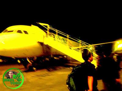 Naik ke pesawat terbang