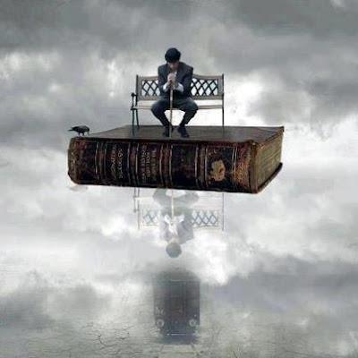 Libro de fantasía debajo de un hombre sentado