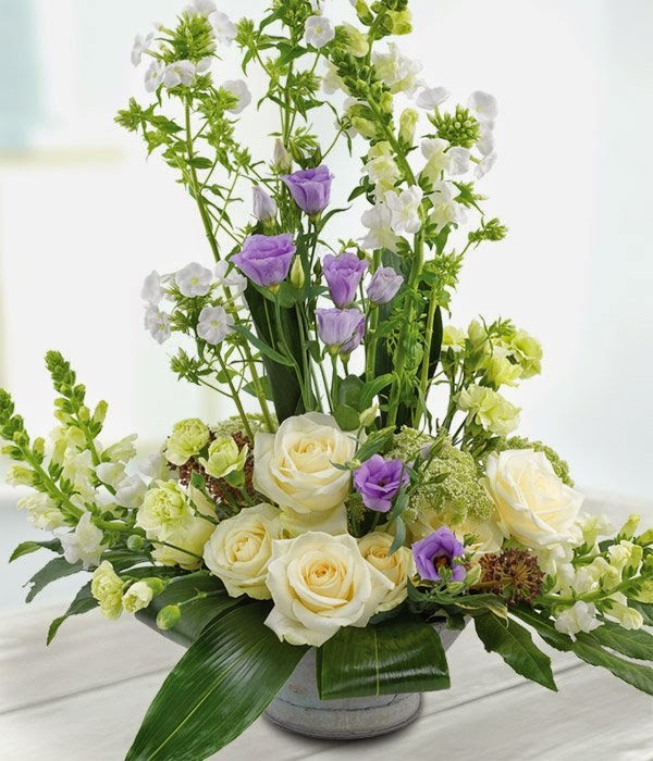 Zinc Urn Arrangement - Cream Roses, Blue and White Flowers.