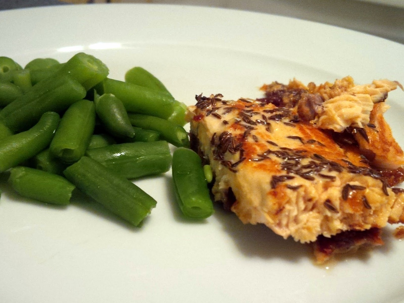 Lemon Caraway Salmon served with green beans.
