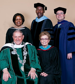 College administrators in commencement robes