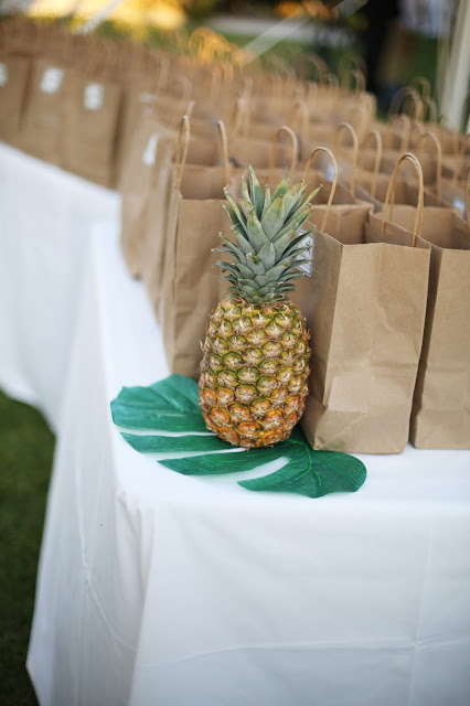 sanibel island wedding photograph with pineapple welcome bags