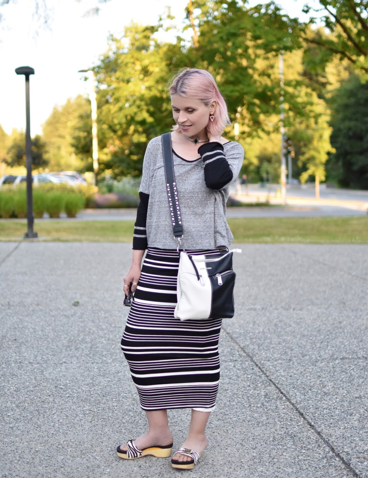 Monika Faulkner personal style inspiration - styling a baseball tee with a striped midi-length pencil skirt and Dr. Scholl's-inspired sandals