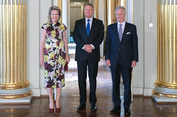 Queen Mathilde wore Erdem Finn dress bloomsbury yellow satin. Mr. Klaus Iohannis, President of Romania