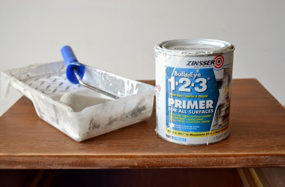 Use a roller to apply primer on every surface of the nightstand.