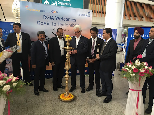 Mr. wolfgang Prock, the CEO of Go Air lighting the lamp at the launch of the Flight services from Hyderabad
