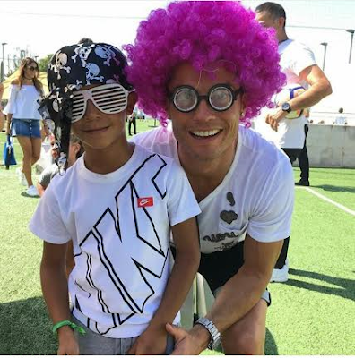 C Ronaldo on  pink wig with his son