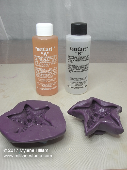 FastCast resin and silicone putty moulds ready for casting.