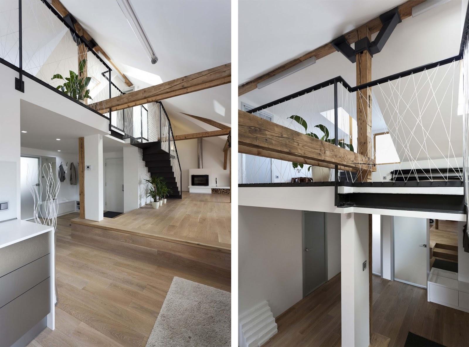 Illuminazione soggiorno con travi a vista sottotetto una casa