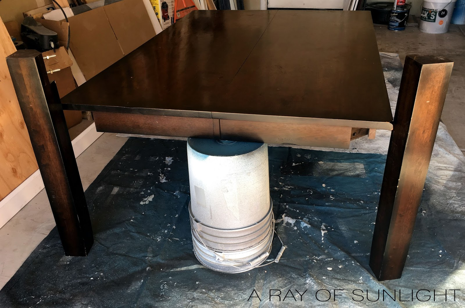How to strip or remove an old stained finish from wood furniture. We found this thrifted dining table online for cheap, and removed the old stained finish to create a weathered wood rustic finish. You can do this with any type of wood furniture like a dresser, table, vanity or buffet to get a farmhouse style feel.