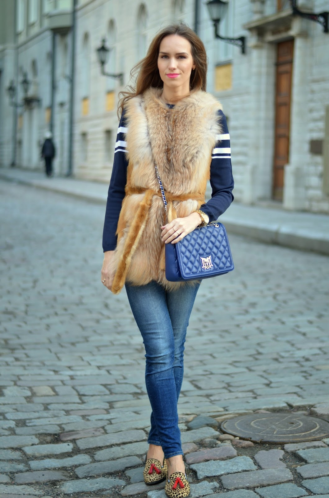 red-fox-fur-vest-blue-quilted-bag-blue-jeans-leopard-flats kristjaana mere