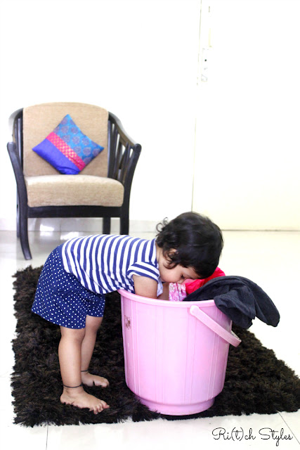 Aryaa's-attempt-to-be-just-like-mom-helping-mom-sorting-clothes-for-wash-ritchstyles-daughter-surfexcel-baby
