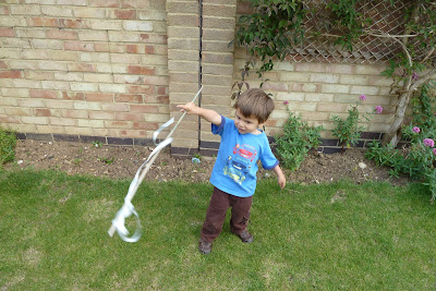 Child playing with streamers