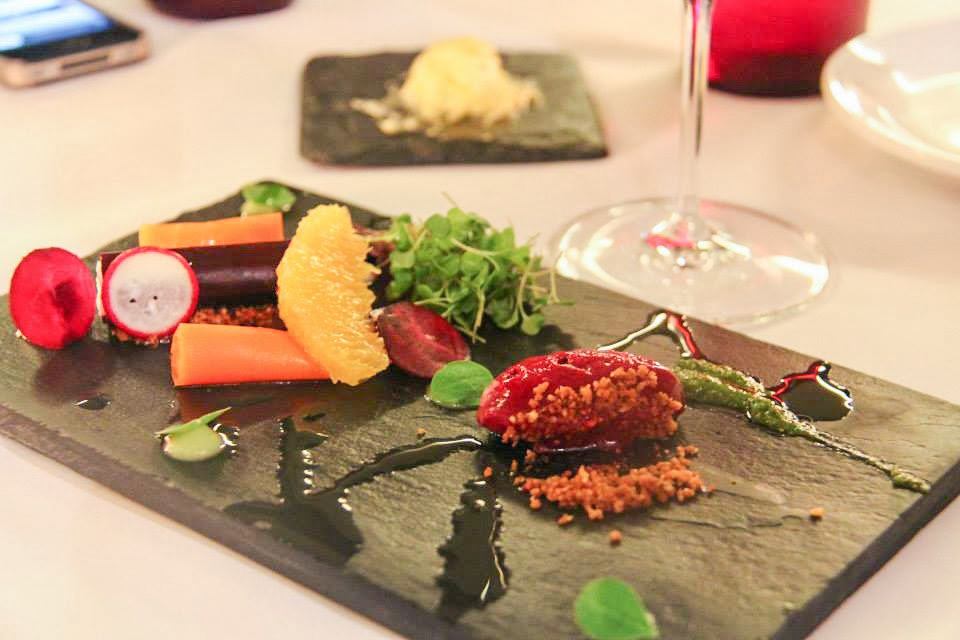 Beet Garden composed of beets, carrots, coffee crumbs, goat cheese, and asparagus coulis.