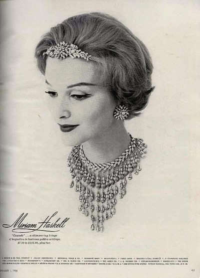 Black and White magazine ad from 1958 featuring model wearing Miriam Haskell jewelry
