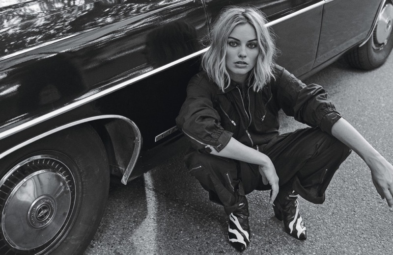 Margot Robbie wears Nili Lotan jumpsuit, Gucci shirt and Louis Vuitton boots