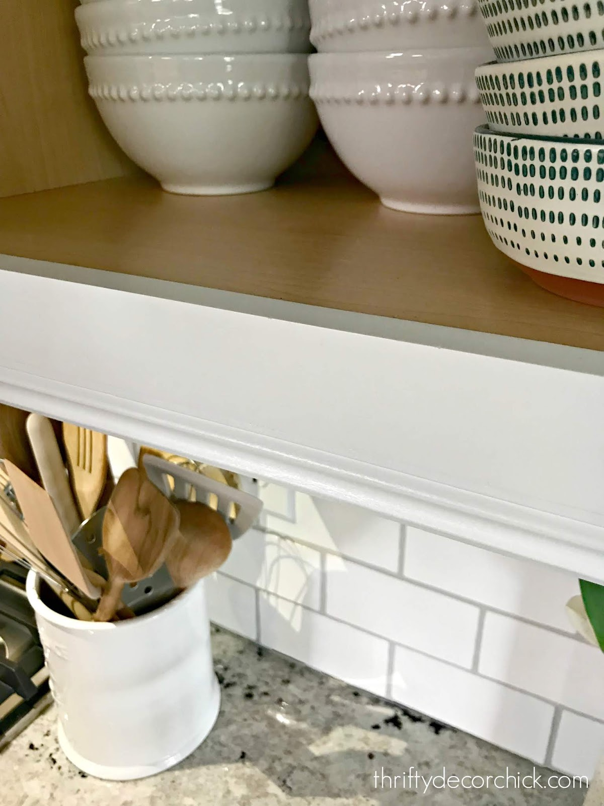 Decorative molding under cabinets