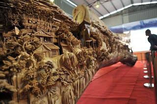 http://verynicethings.es/2013/12/guinness-premia-una-espectacular-escultura-de-madera-de-guiness/