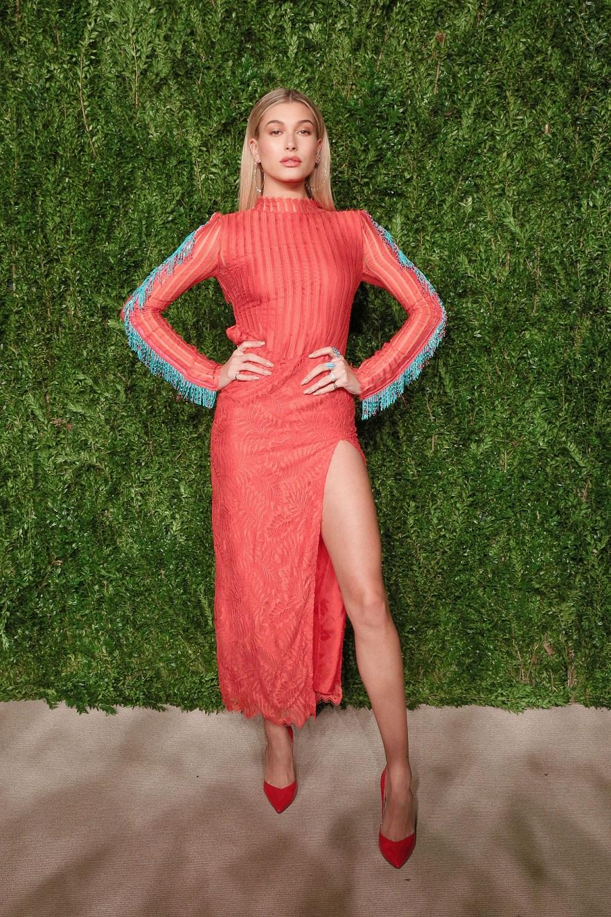 Hailey Baldwin wears thigh flashing dress to the 13th Annual CFDA Vogue Fashion Fund Awards
