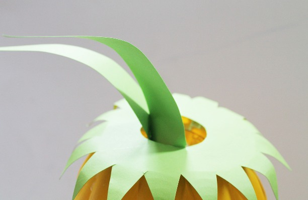 Cut out spear shapes, apply glue to the base and apply to the inside of the plastic bottle