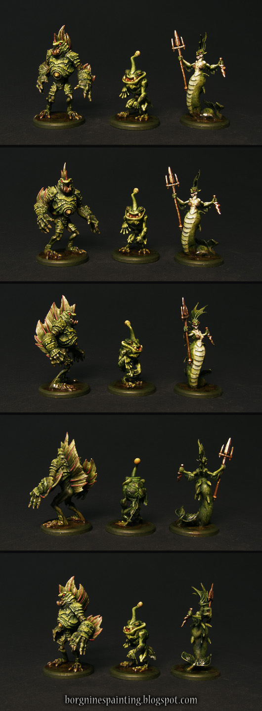 The whole family of tritons, 3 miniatures of greenish fish-people visible from several angles and standing on round bases.