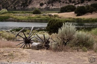 Cramer Imaging's professional quality natural scenic landscape photograph of wagon wheels, axle, and sagebrush on the Snake River at Massacre Rocks, Idaho