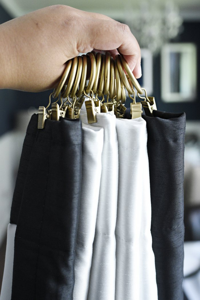 Use curtain rings to give your store bought/inexpensive curtains a luxe, custom made look. These black and white curtains are gorgeous with the gold curtain rings. | via monicawantsit.com