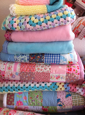 Snuggly quilts and blankets i sell in my shop