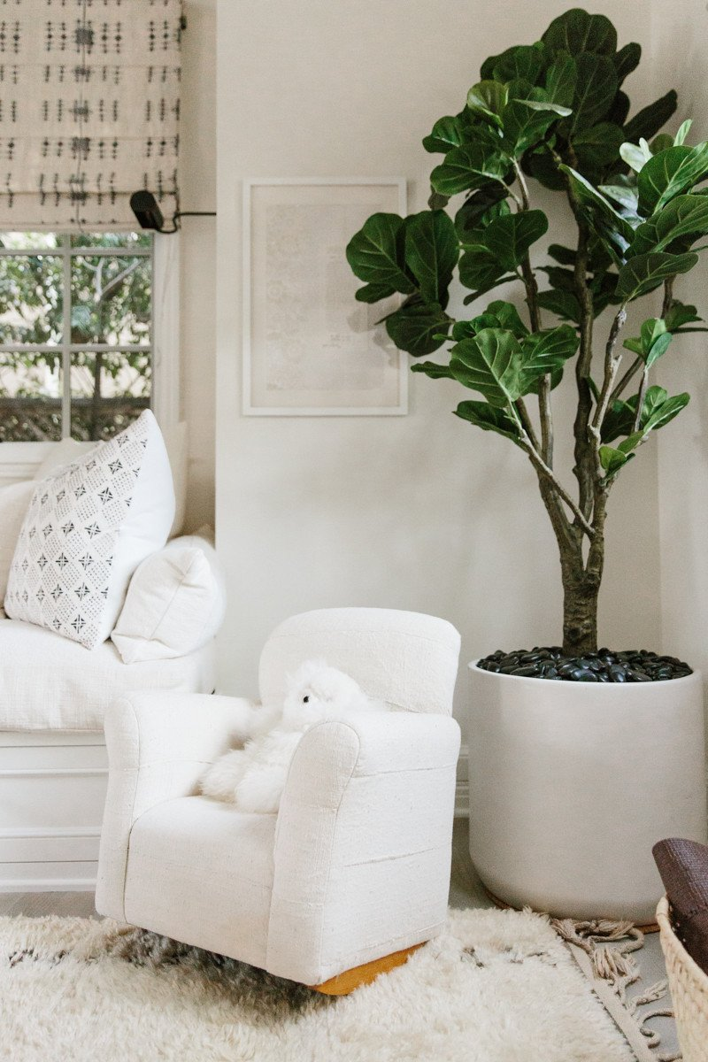 Erin Fetherston den with fiddle leaf tree and child's rocking chair