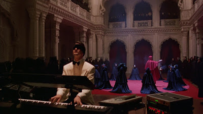 Nick Nightingale plays the piano blindefolded at a secret gathering, Directed by Stanley Kubrick