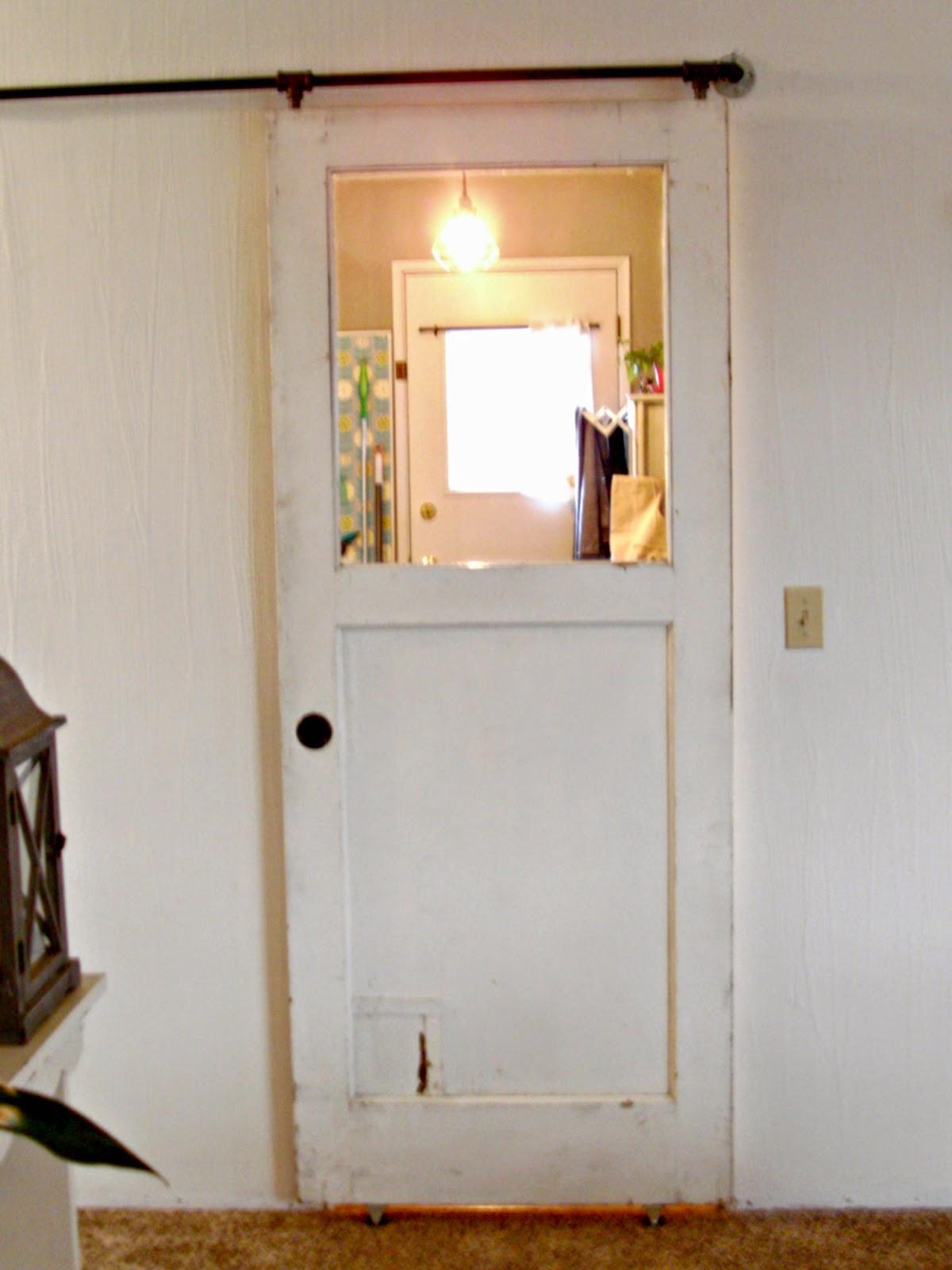 Laundry room redo diy sliding rustic door little for Sliding laundry door