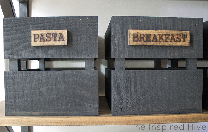 DIY wooden crate pantry storage with woodburned labels