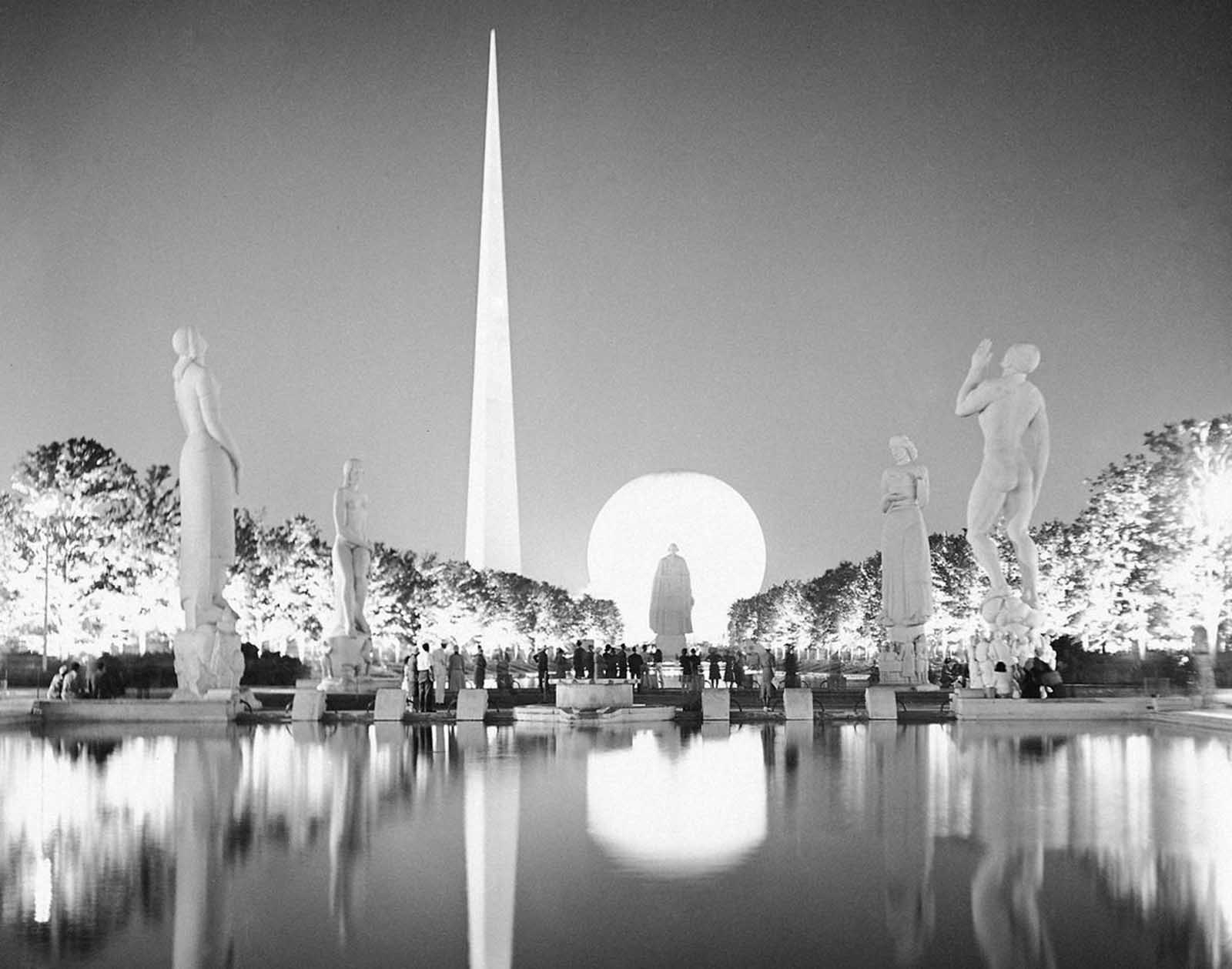 A view taken from the side of one of the many lagoons at the New York World's Fair on July 7, 1939. Light brings out some of the wondrous beauty as erected at the