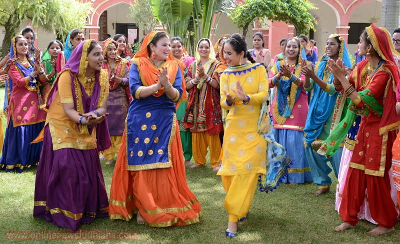 Students in Traditional Punjabi Dresses performing Giddha during Teej Celebrations at KCW