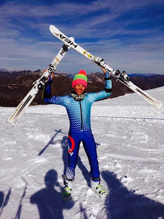 skis above head blue speed suit