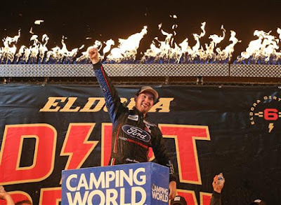 Chase Briscoe, driver of the #27 Ford Ford, celebrates in Victory Lane after winning the NASCAR Camping World Truck Series Eldora Dirt Derby at Eldora Speedway on July 18, 2018 in Rossburg, Ohio.