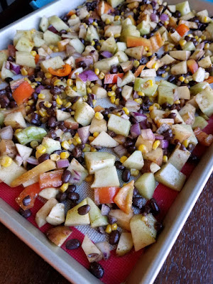 sheet pan filled with diced veggies and black beans