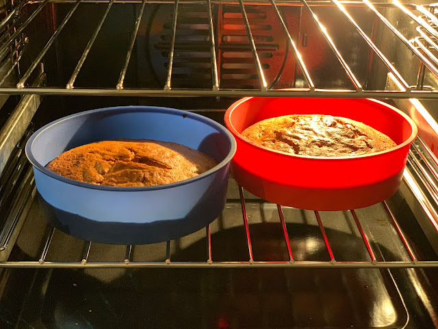 A close up view of the inside of the main oven with cake baking in 2 silicone cake tins