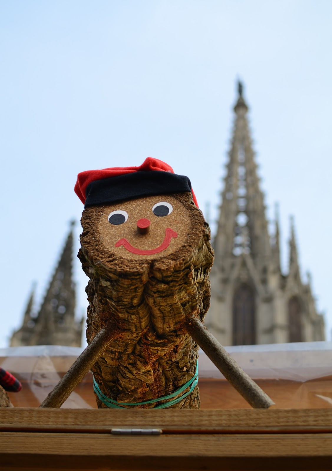Caga Tió with Barcelona Cathedral in the background