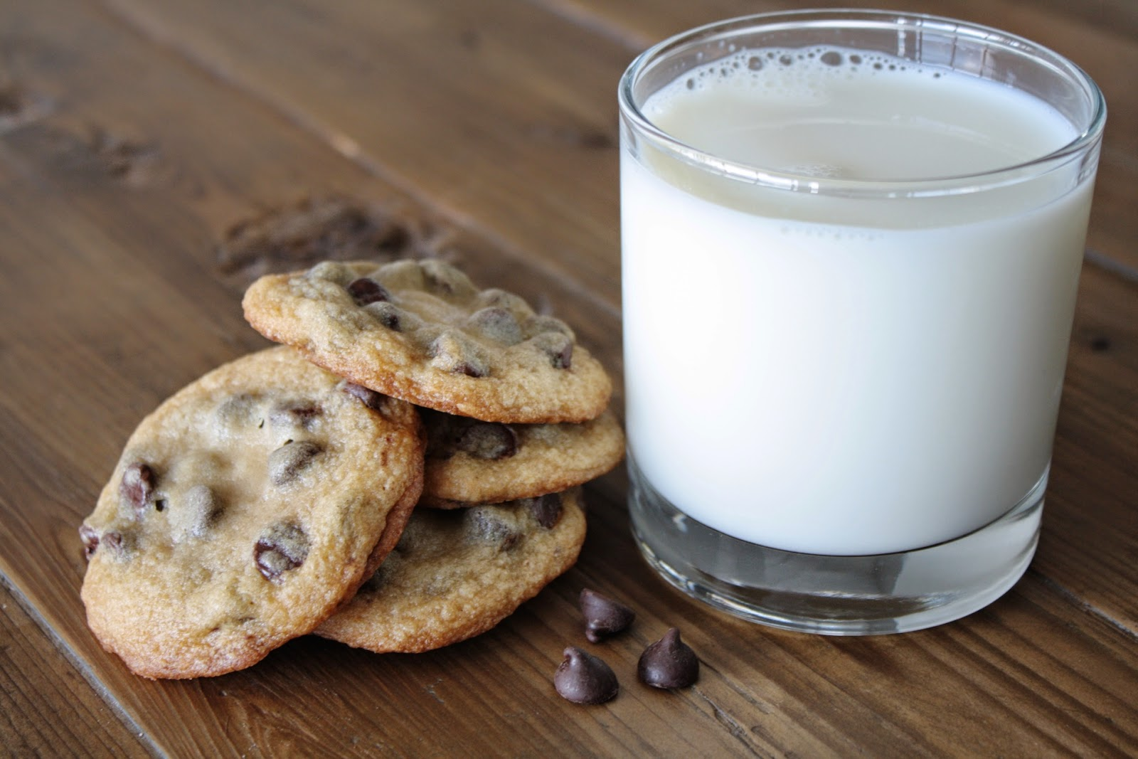 Cookies with a glass of milk beside them.