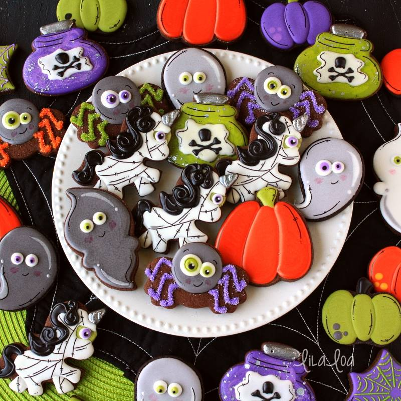 Halloween decorated sugar cookies -- mummy unicorns, spiders, ghosts, pumpkins and potions