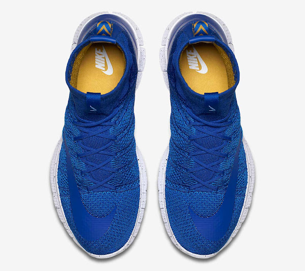 2298a518cb9f Nike combines the solid blue upper with a white midsole that boasts a  remarkable splatter graphic pattern